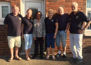 Maltby (Rother Valley) Lions install a security light for Carol Gott