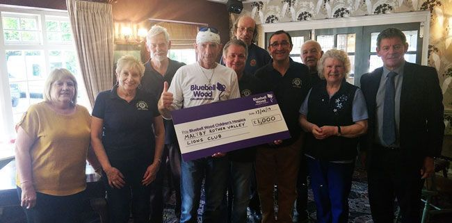 Maltby (Rother Valley) Lions Club prent cheque to Harry for Bluebell Wood Children's Hospice